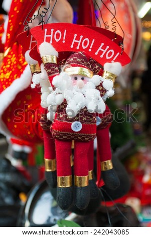 Christmas decorations. Vietnamese stores start selling xmas decorative products from late November every year on Hang Ma street, old quarter of Hanoi - stock photo
