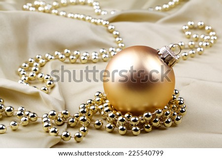 Christmas decorations with bauble and golden ribbon