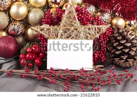 Christmas decorations with blank card on silver background