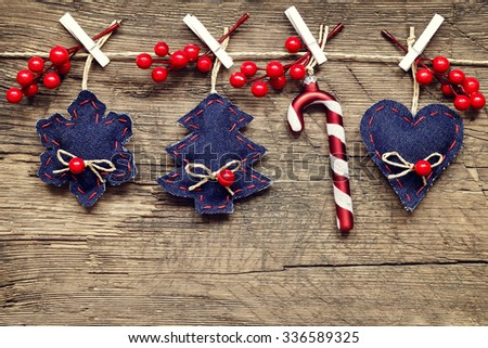 christmas decorations with ornaments on wooden background - stock photo