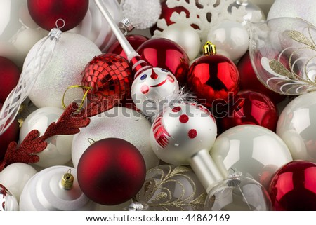 Christmas decorations with red, white and silver balls and a snowman tree topper. - stock photo