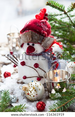 Christmas Decorations with snowman,candles and christmas baubles - stock photo