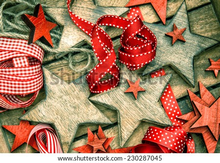 christmas decorations wooden stars and red ribbons for gifts wrapping. vintage style ornaments - stock photo