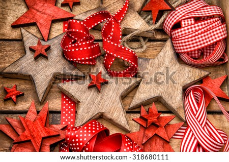 Christmas decorations wooden stars and red ribbons. Nostalgic retro style toned picture