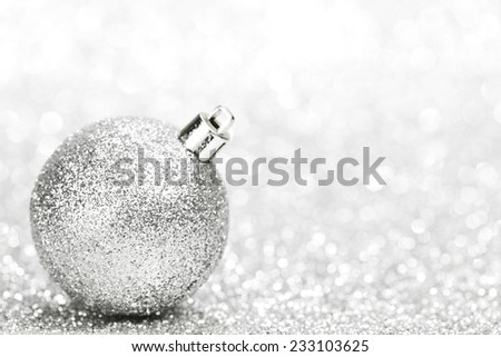 Christmas decorative ball on light silver bokeh background - stock photo