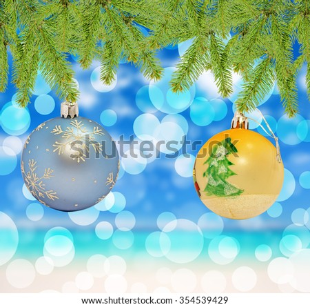 Christmas decorative blue and yellow ball on bokeh background