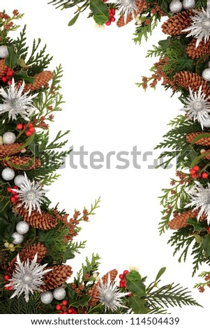 Christmas decorative border of holly, ivy, mistletoe, cedar leaf sprigs with pine cones, silver baubles and thistle sprays, emblem of scotland over white background. - stock photo