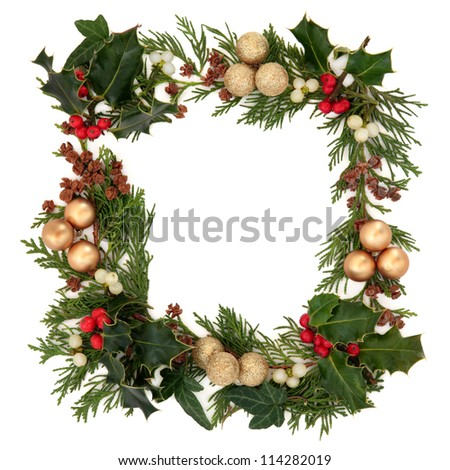 Christmas decorative border of holly, mistletoe, ivy, cedar and gold baubles over white background. - stock photo