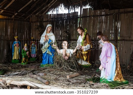 Christmas decorative creche with Holy family of Joseph, Mary, baby Jesus Christ and the wise men - stock photo