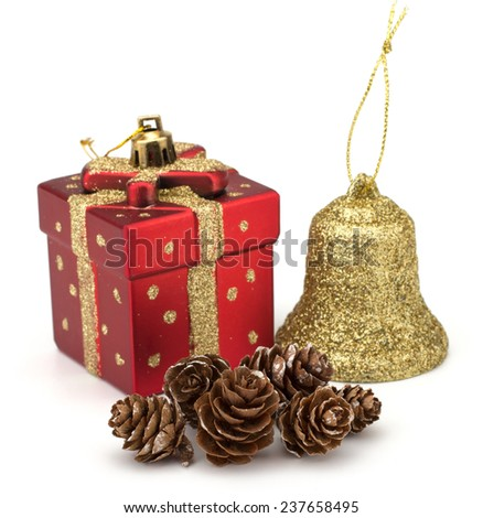 Christmas decorative gift box, bell and pine cones isolated on white background - stock photo