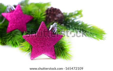 Christmas decorative stars on fir tree, isolated on white - stock photo