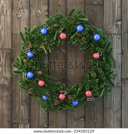 Christmas decorative wreath with balls on wood