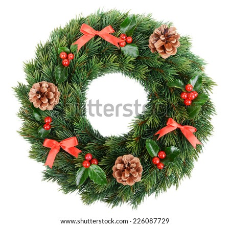 Christmas decorative wreath with leafs of mistletoe isolated on white - stock photo