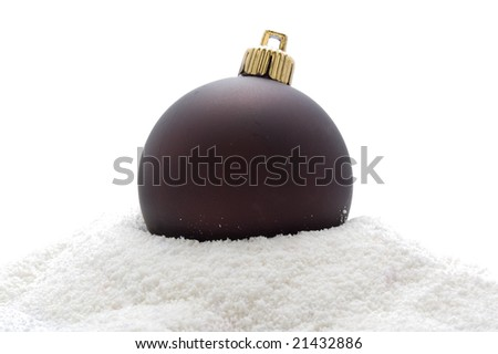 Christmas deep brown ball in snow, isolated on white background - stock photo