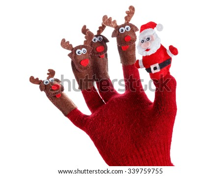 Christmas deer toy decoration on the hand. Humorous concept festive fun - stock photo