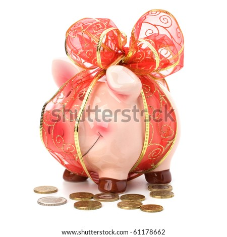 Christmas deposit concept. Piggy bank with festive bow isolated on white. - stock photo