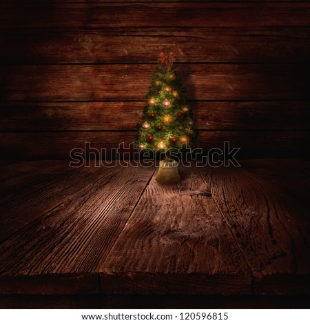 Christmas design - Christmas tree. Xmas winter background in wooden cabin with Christmas tree and wall in the background. - stock photo