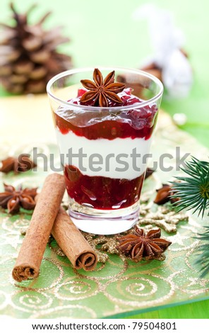 christmas dessert in a glass with decoration - stock photo