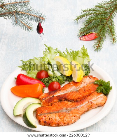 Christmas dinner for fish men - fir decorated with wobbler - stock photo