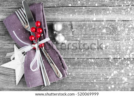 Christmas dinner plate decoration with xmas ornaments on old wood background. Merry christmas card. Winter holiday theme. Happy New Year. Space for text. Glitter snow effect.