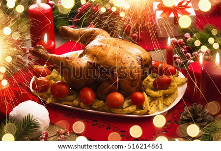 Christmas dinner. Roasted chicken, table setting Holidays background