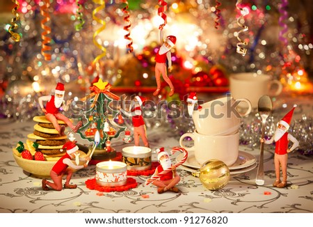 Christmas dinner table prepared by seven dwarfs - stock photo