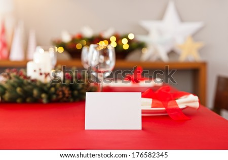 Christmas dinner table setting with name card in red - stock photo