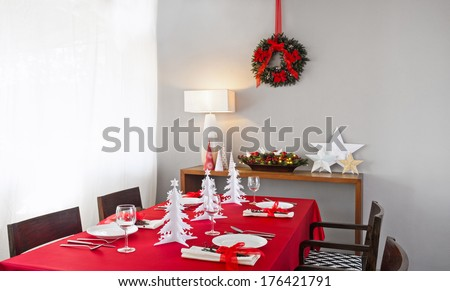 Christmas dinner table setup with decoration on the side board - stock photo