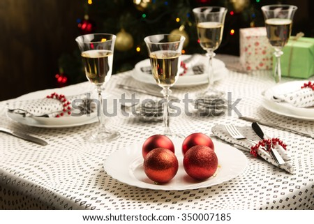 Christmas dinner table. Traditional Christmas decorations. Served table in a restaurant. Beautifully set table for Christmas Eve. - stock photo