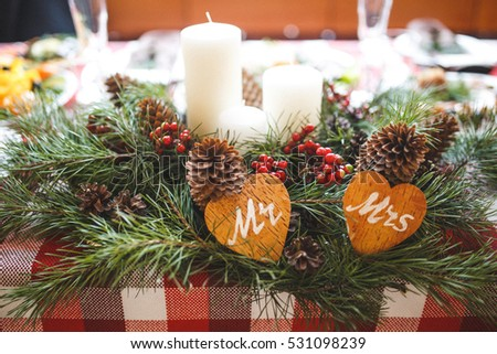 Christmas dinner table with candles for her and for him