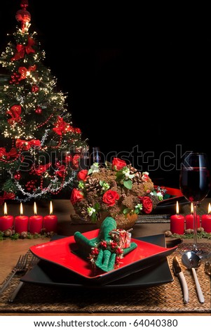 Christmas dinner table with elegant napkins in red and green - stock photo