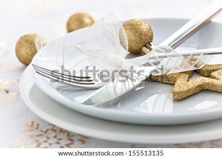 christmas dinner with golden decoration - stock photo