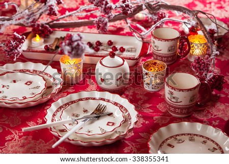 Christmas dishes, cutlery and decor in red and white
