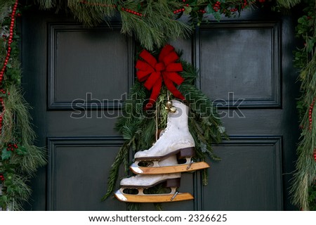 Christmas Door with Ice Skates - stock photo