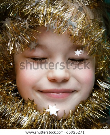 Christmas dream - close up of cute happy child - stock photo