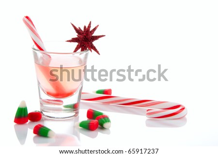 Christmas drink, candies, canes and candycorns isolated on a white background - stock photo