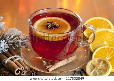 Christmas drink punch and spices on colorful background - stock photo
