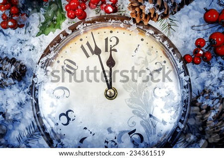 Christmas Eve and New Years at midnight. Clock covered with snow. - stock photo