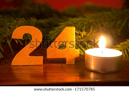 Christmas Eve, candle and branch - stock photo