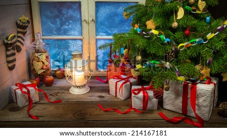 Christmas eve in warm and cozy rustic cottage