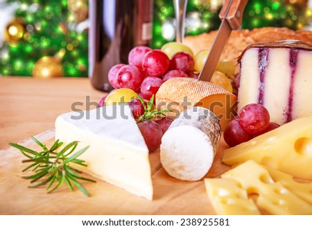 Christmas eve table, festive food still life, romantic cheese and wine set up, celebrating Xmas party at home - stock photo