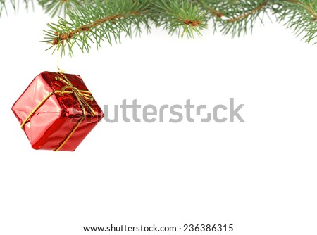 Christmas evergreen spruce tree and a gift - stock photo