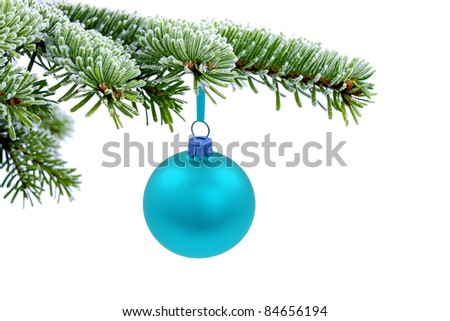 Christmas evergreen spruce tree and blue glass ball on snow background - stock photo