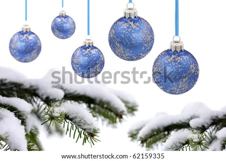 Christmas evergreen spruce tree, glass ball and snow - stock photo