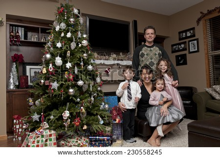 christmas fam'ly pic / gathered round the christmas tree / fam'ly memories - stock photo