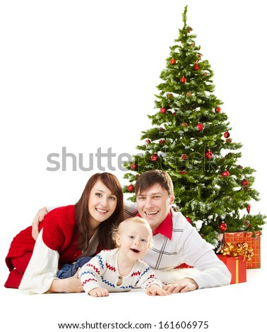 Christmas family and baby in front Christmas fir tree. Isolated white background  - stock photo