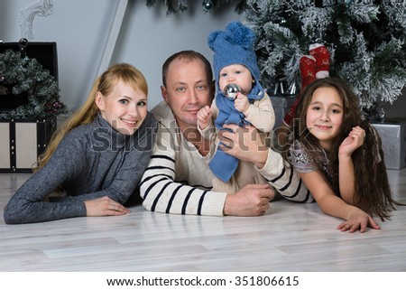 Christmas family. Happy parents and children - stock photo