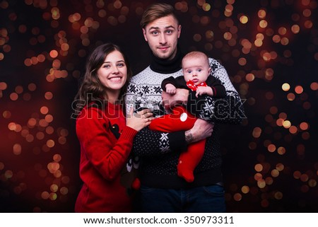 Christmas family of four persons black  background - stock photo