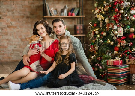 Christmas Family Portrait In Home Holiday Living Room, Kids and Baby With Present Gift Box, House Decorating By Xmas Tree Candles Garland - stock photo