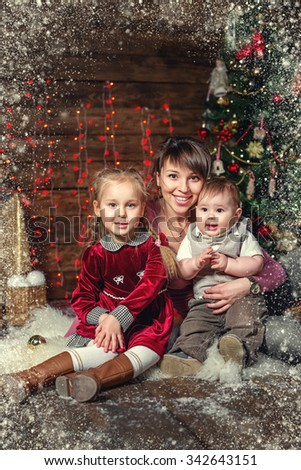 Christmas Family Portrait In Home Holiday Living Room, Kids and Baby With Present Gift Box, House Decorating